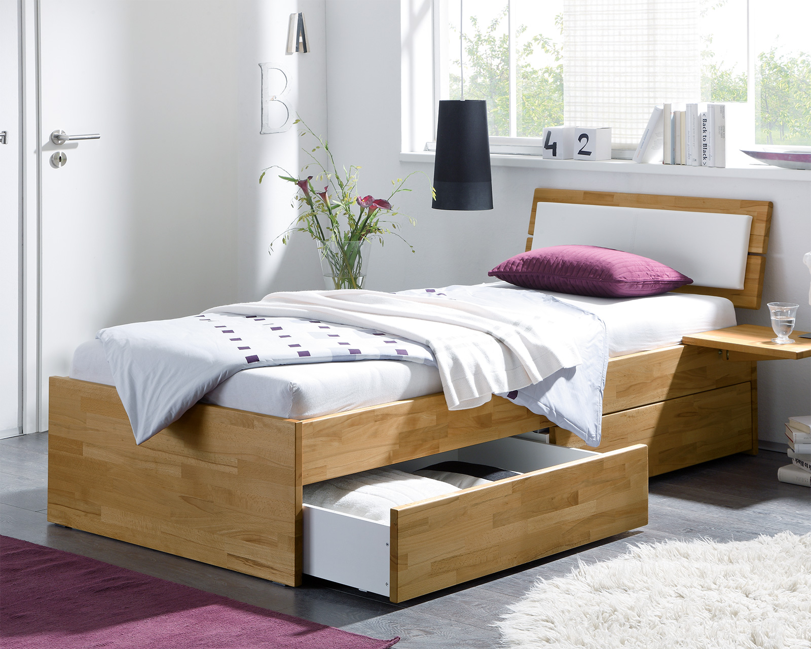 moderne einzelbett leova aus massiver kernbuche mit zwei schu. Black Bedroom Furniture Sets. Home Design Ideas