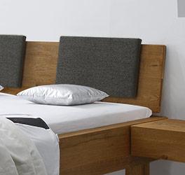 Bett Kasos mit optionalen Einsteck-Kissen fürs Kopfteil