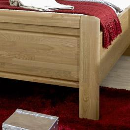 Bett Quebo inklusive Fußteil aus Massivholz
