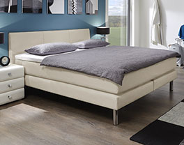 boxspringbett aus kunstleder in braun asturina. Black Bedroom Furniture Sets. Home Design Ideas