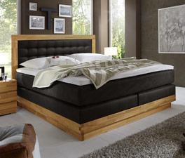 Boxspringbett Olbiano mit Luxus-Kunstleder und einem massiven Holzrahmen