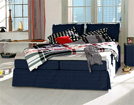 Marinefarbenes Boxspringbett Tom Tailor Cushion mit 5-Zonen-Matratze