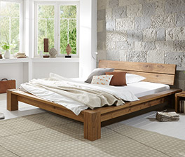 Tolles Design Massivholzbett Navia in Wildeiche Natur.