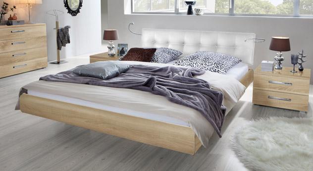 Das Bett Cosenza aus MDF in Eiche sägerau natur und Kunstleder in Weiß