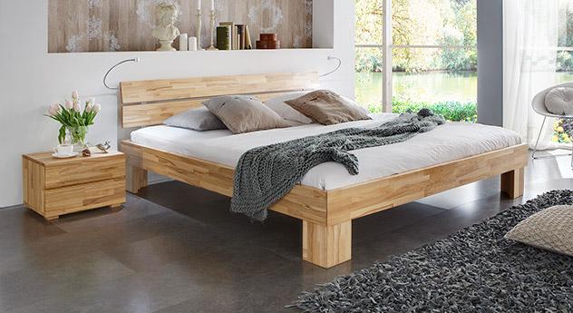 Bett Lucca Komfortt in Kernbuche natur mit einer Fußhöhe von 25cm