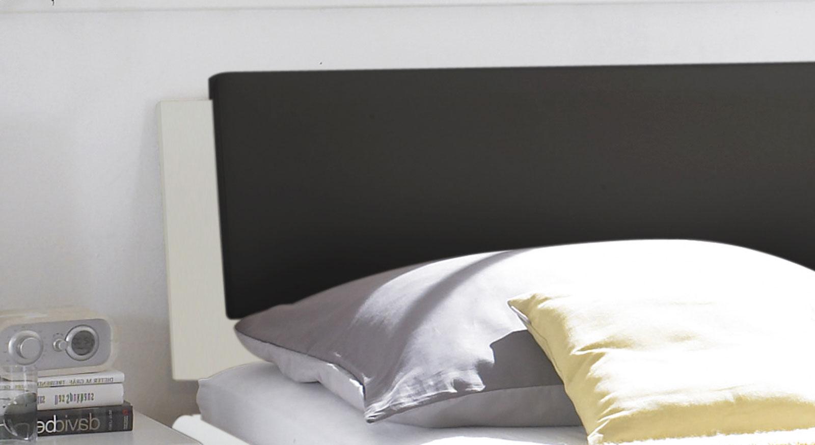 Das Bett Mendo  mit weißem gepolsterten Kopfteil