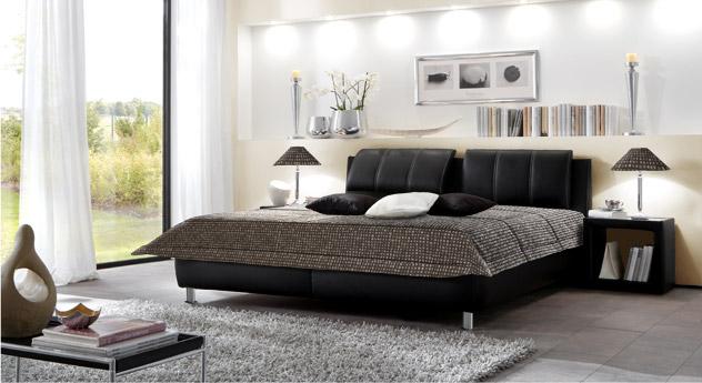 schwarzes polsterbett mit verstellbarem kopfteil carisio. Black Bedroom Furniture Sets. Home Design Ideas