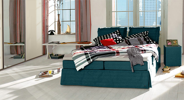 Boxspringbett Tom Tailor Cushion in petrolfarbenem Webstoff