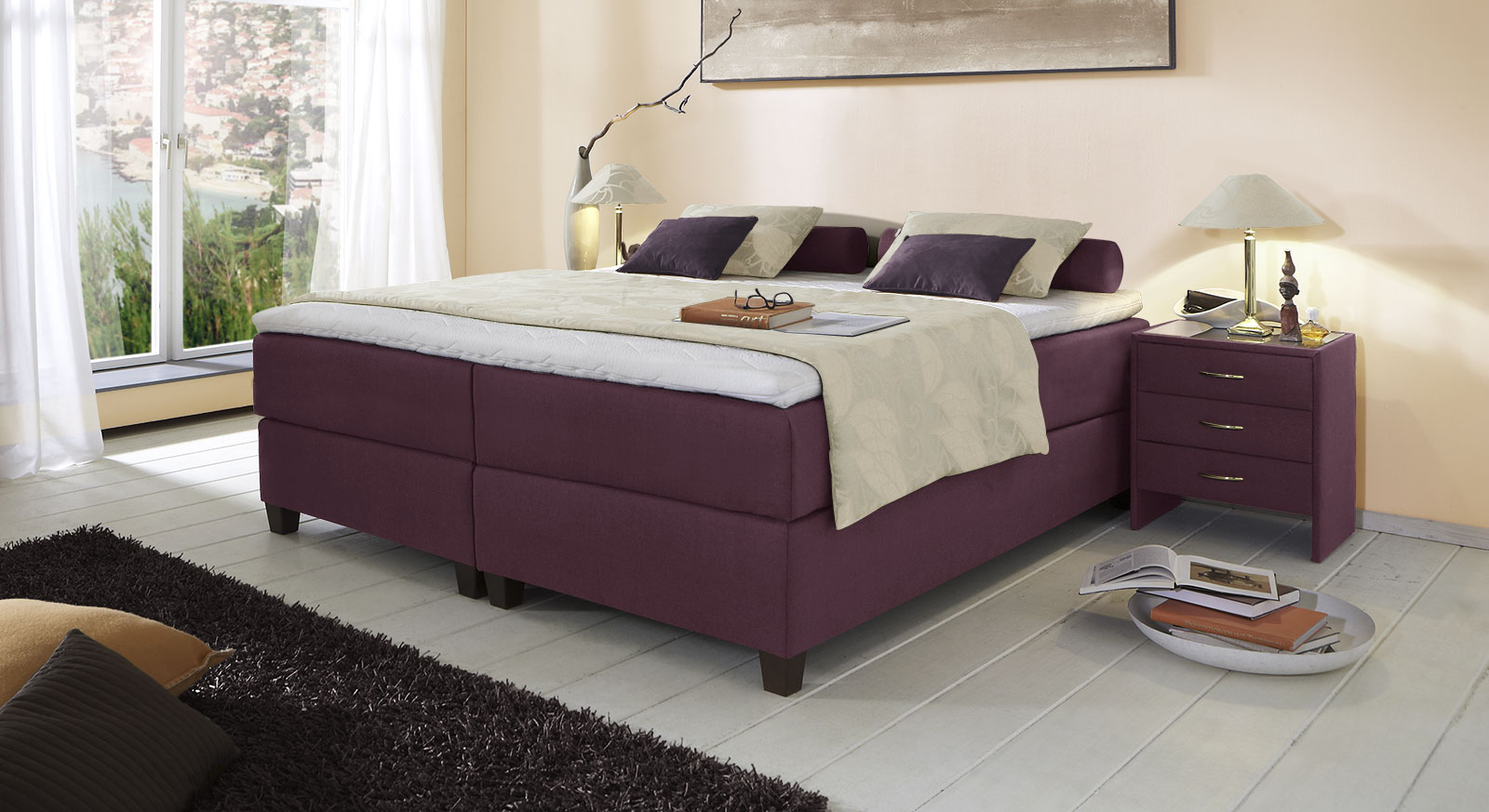 Boxspringliege Luciano in 66 cm Höhe mit Stoffbezug in Beere