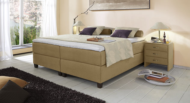 Boxspringliege Luciano in 66 cm Höhe mit Stoffbezug in Jute