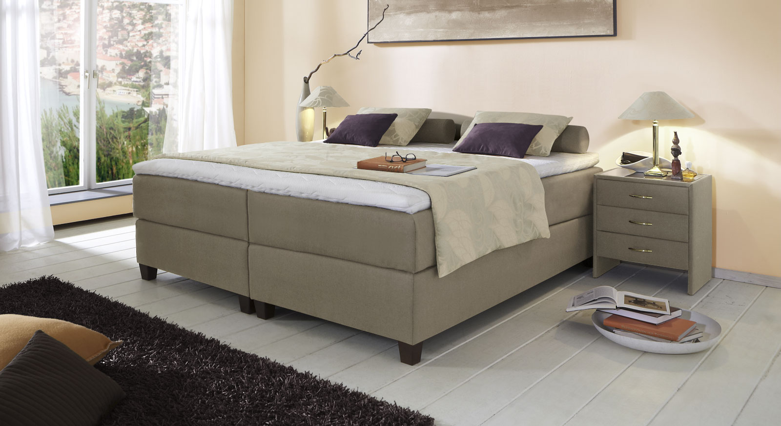 Boxspringliege Luciano in 66 cm Höhe mit Stoffbezug in Taupe