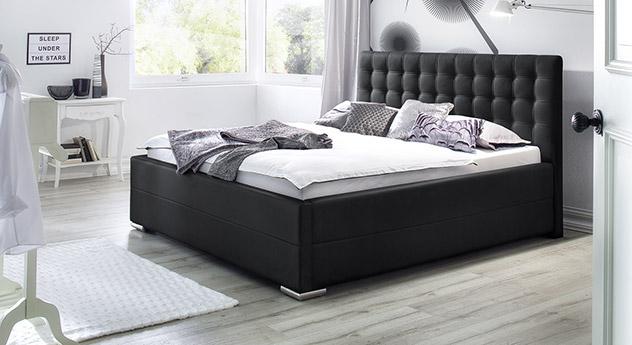 Komfortables Polsterbett Pattani aus schwarzem Kunstleder