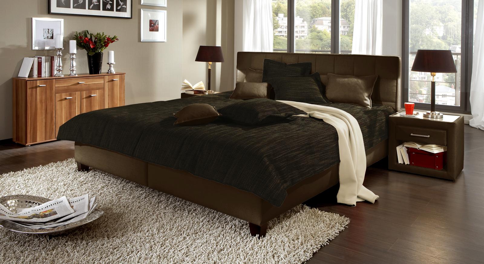 Hier ist das Polsterbett Sansone in dunkelbraunem Webstoff mit Bettkasten abgebildet.