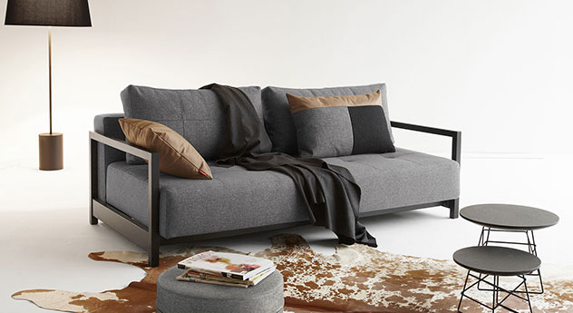 schlafsofa in grauem webstoff mit r ckenkissen butland. Black Bedroom Furniture Sets. Home Design Ideas