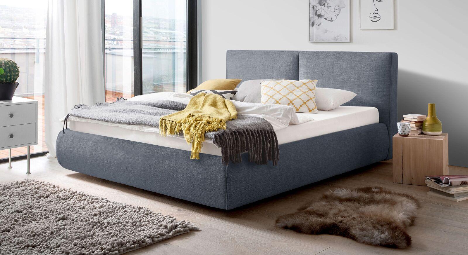 Bett Astarte mit blauem Webstoffbezug