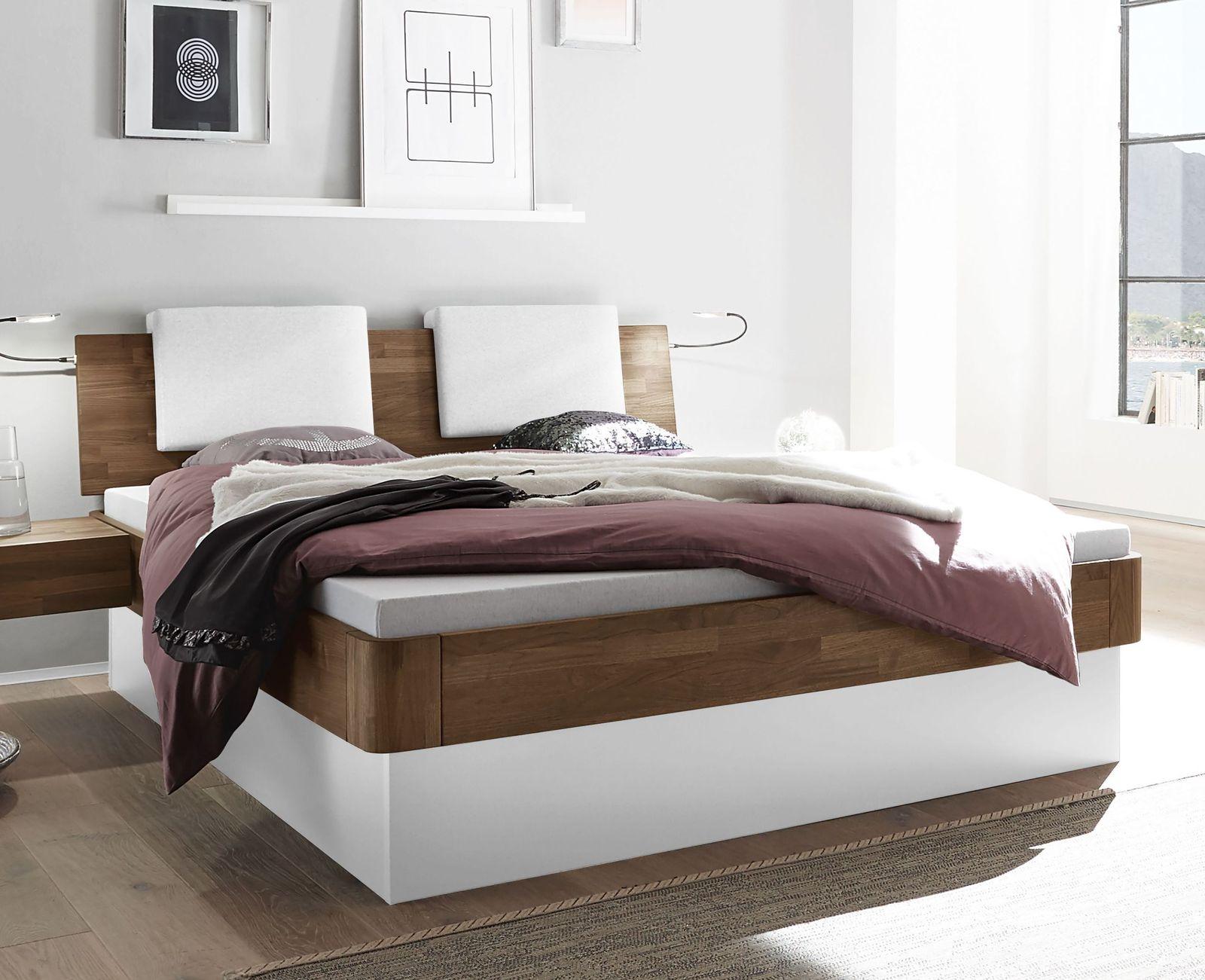 stauraumbett aus massivem nussbaum mit bettkasten tartu. Black Bedroom Furniture Sets. Home Design Ideas