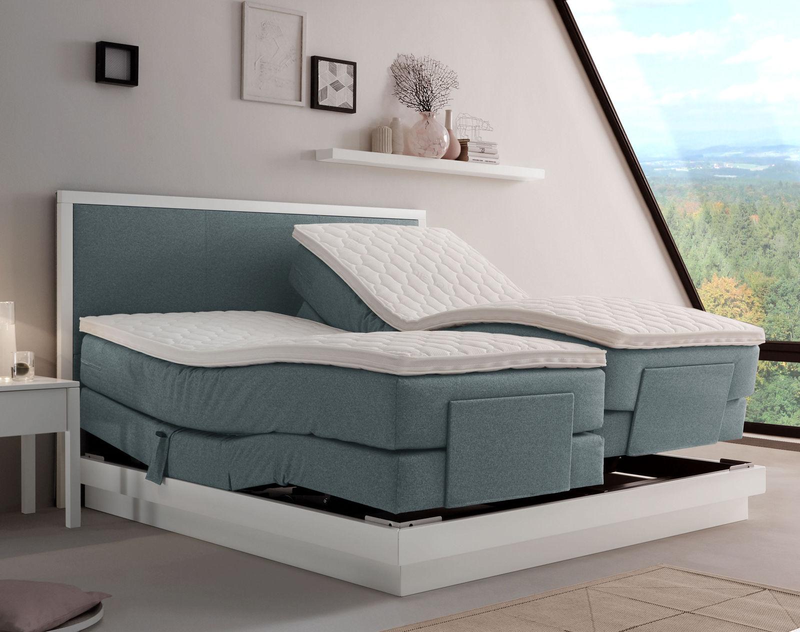modernes boxspringbett mit motor und wei em buchensockel pando. Black Bedroom Furniture Sets. Home Design Ideas
