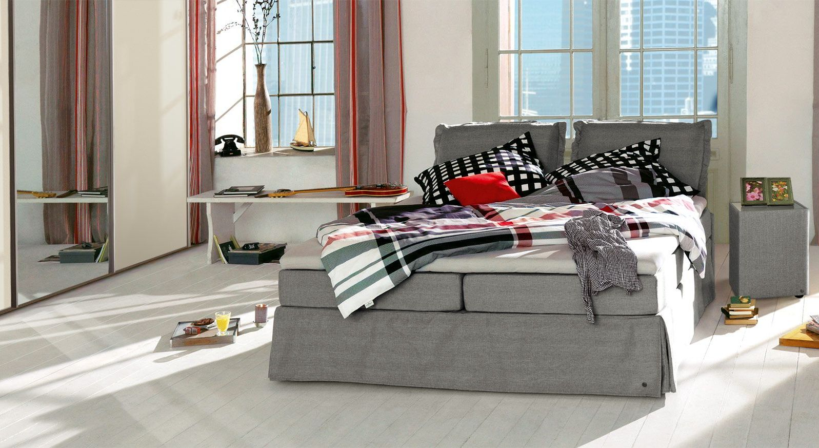 Boxspringbett Tom Tailor Cushion in grauem Webstoff