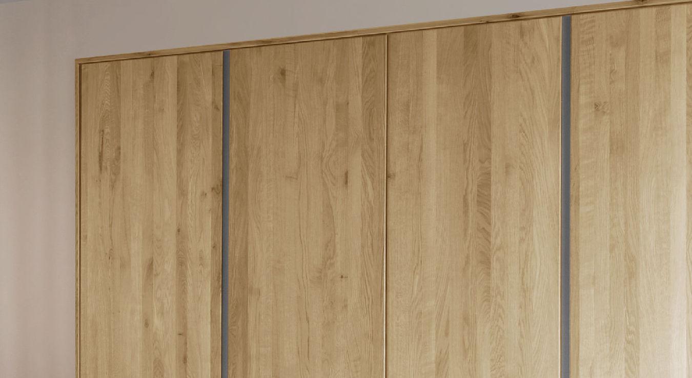 Drehtüren-Kleiderschrank Nidau mit lackierten Stahl-Zierleisten