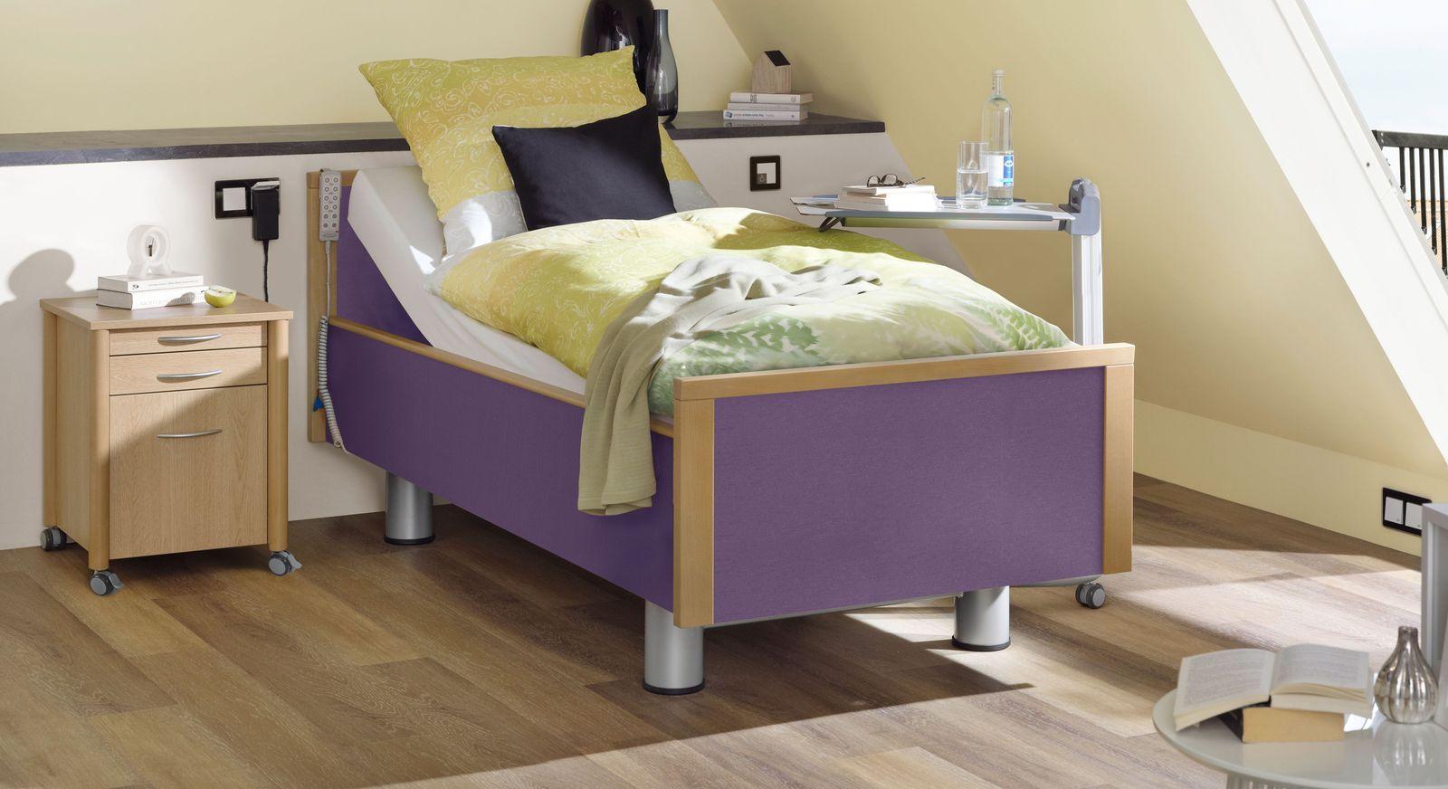 Komfortbett mit Pflegebett-Funktion Mainau mit Stoff in freundlichem Violett