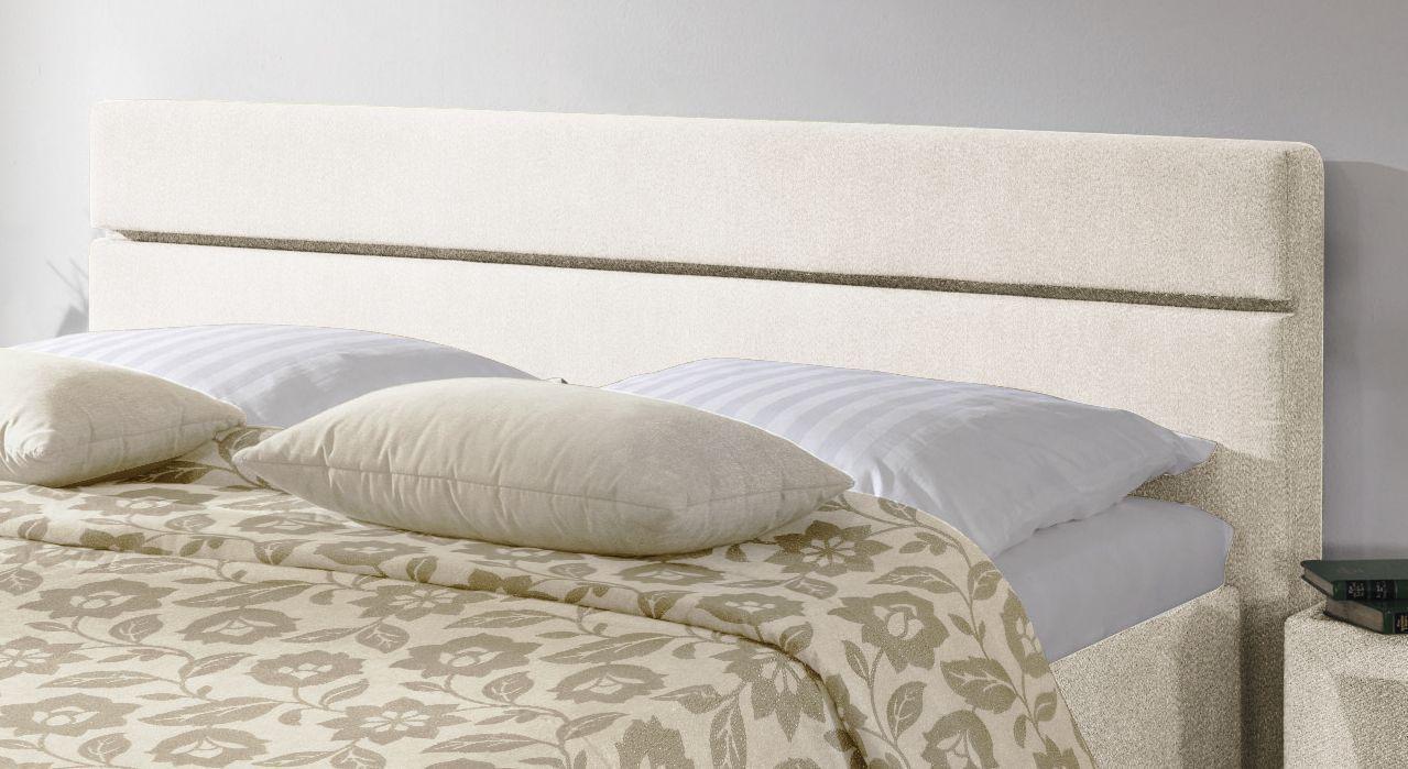 Das Cremefarbene Polsterbett Severo hat ein bequemes Kopfteil