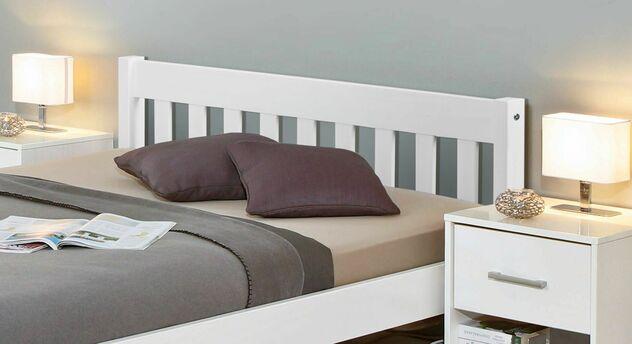 Bett Genf mit dekorativen Metallstangen am Kopfteil