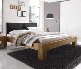 Bett Maia mit rustikalen Blockfüßen
