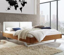 Bett Poncas in stilvollem Materialmix