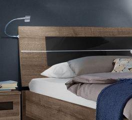 Bett Surano inklusive Kopfteil mit schwarzer Glasplatte