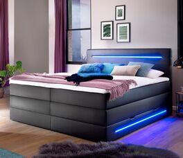 Bettkasten-Boxspringbett Tollocan mit blauer Beleuchtung