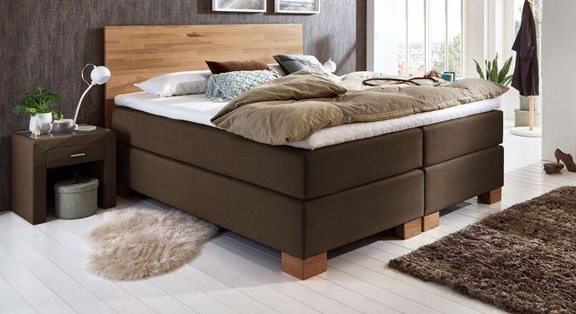 Boxspringbett Peachland in harmonischer Farbkombination zwischen Holz und Stoffbezug