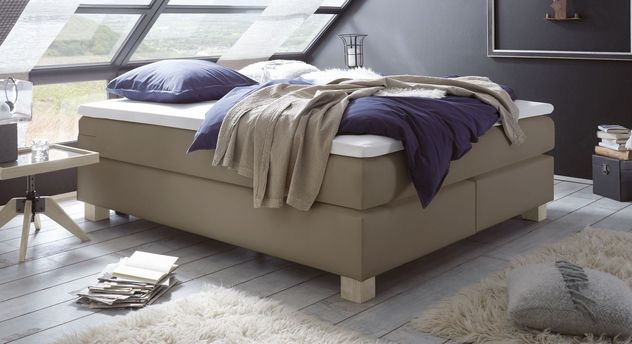 Boxspringliege Goma aus Luxus-Kunstleder in Taupe