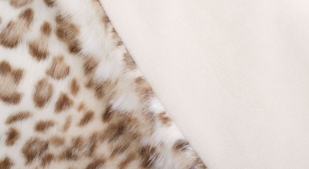 Felldecke Gepard mit cremefarbener Uni-Kehrseite