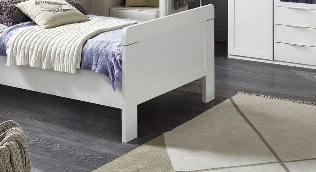 Komfort-Einzelbett Aradeo mit Fußteil und hohem Bettrahmen