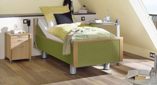 Hochwertiges Komfortbett mit Pflegebett-Funktion Mainau mit grünem Stoff
