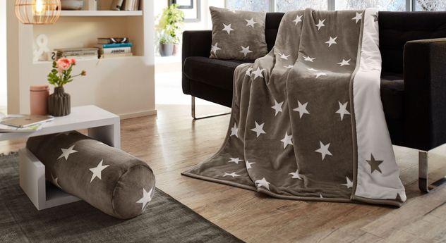 Wohndecke Sternenregen mit passenden Kissen